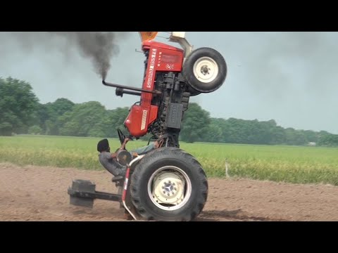 Man Performs Amazing Stunts On Tractor