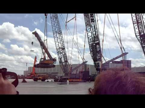 cranes lifting each other