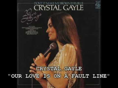 Tekst piosenki Crystal Gayle - Our Love Is On The Faultline po polsku