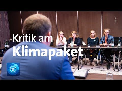 Debatte um Klimaschutz: Aktivisten von FFF und der Vorsitzende der Umweltministerkonferenz
