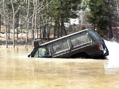 snorkel - Check out my other jeep videos and rate thumbs up if you like to 4x4. My 87 jeep cherokee. I'm playing around in my pond. It is at least 7ft at the deep end....