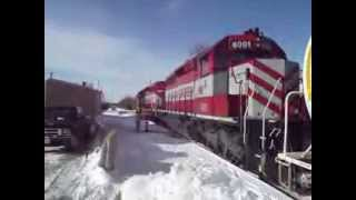 WSOR L355 switching cars behind the Swiss Colony maintenance building on 12/18/13