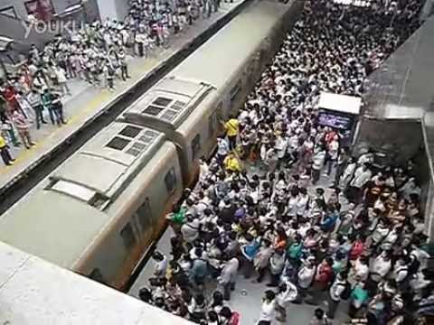 beijing - July 18, 7:30 am, likely the Xierqi subway station on Line 13. http://beijingcream.com/2013/07/beijing-subway-can-get-a-wee-crowded-in-the-mornings/ Source: ...