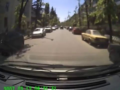 Russia - Dash Cam View Of Car Vs Manhole