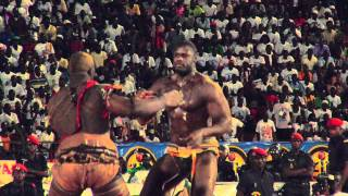 Senegal's most popular sport is wrestling, and this was the biggest match of the year. Modern day gladiators. Thanks to Bouba N'Dour for the media pass to ...