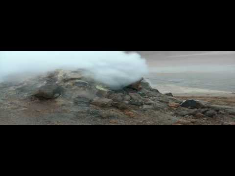 fumarole - May 17, 2010 - Genji stands dangerously close to a steaming, stinking fumarole at the Hverir geothermal field in northern Iceland. It was like being on the M...