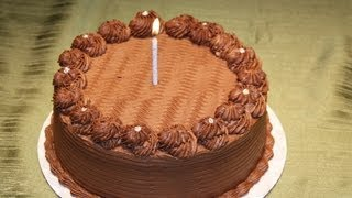 Learn how to decorate a chocolate cake with ganache filling. Ganache is also great for cupcake decoration. Easy and simple ...