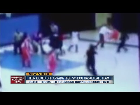 Fight breaks out during H.S. basketball game.. See how coach reacts