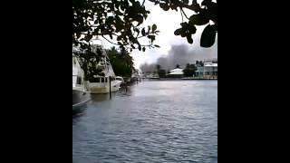 Seen from a distance the boat fire at bahia mar today. 12/13/2013.