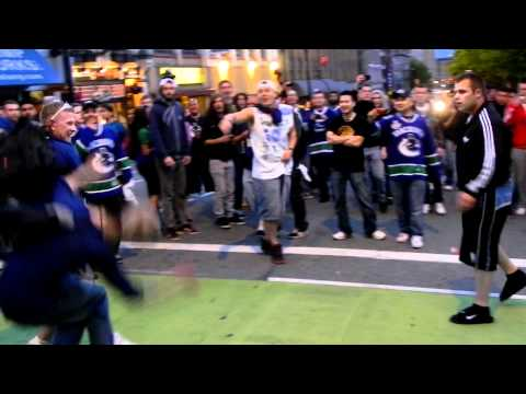 Vancouver Riots 2011 - Live Raw Footage - Guy Knocked Out With One Punch