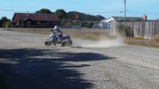 4. 8 yr old doing doughnuts on his Polaris outlaw 110