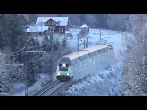 Finnish InterCity train 960 and Pendolino 955 passing a railway tunnel