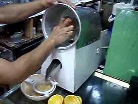 estractor de jugos de naranja
