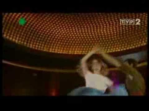 Tekst piosenki Krzysztof Krawczyk - Ostatni raz zatańczysz ze mną po polsku