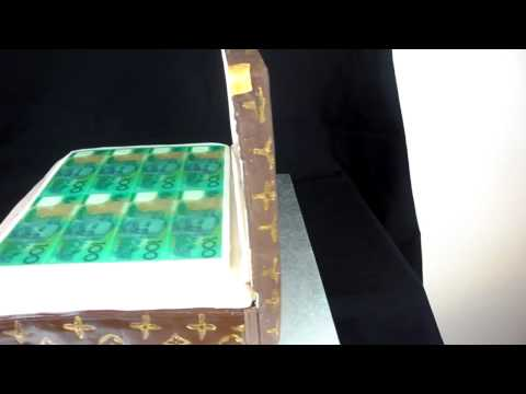fondant suitcase cake - This cake is a birthday cake made with LV stamp (hand made) on fondant and gum paste cake, hope you like it.