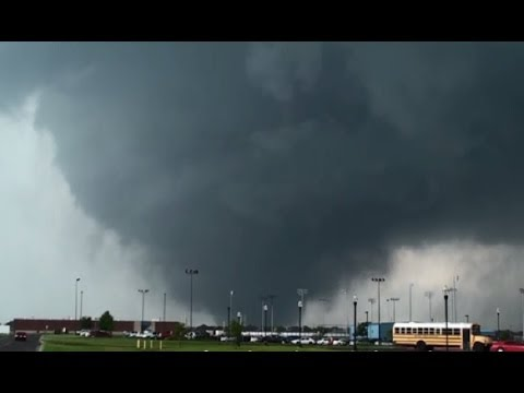 moore - Large, violent tornado plowed through Moore, OK. We intercepted the tornado from within a half mile by South Moore High School. Complete destruction...prayer...