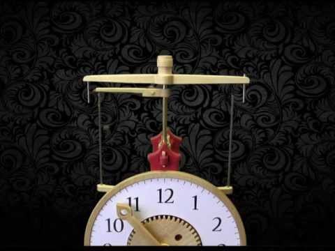 Brian Law - Clock 17 The flying pendulum clock is a clock that uses a flying pendulum escapement mechanism. A small metal ball, connected by string wraps around one stee...
