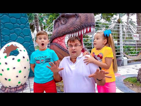 Diana and Roma walk in the Dinosaur park & Museum of Illusions