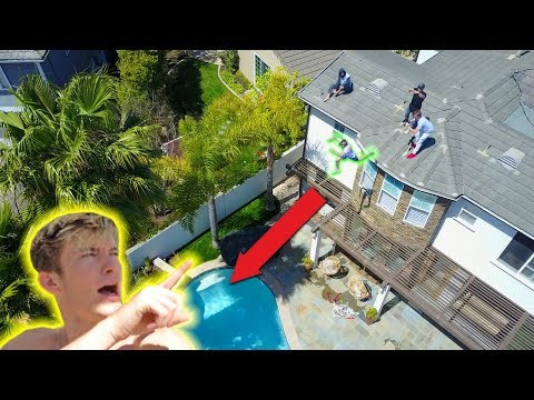 HUGE ROOF JUMP OFF OUR NEW HOUSE!!