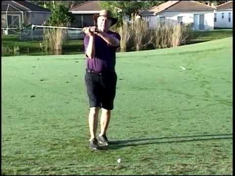 ball above the feet below the feet golf lesson