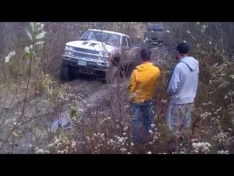 Lifted Chevy helps pull out a Dodge