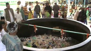 Ajmer India  city photos gallery : Throwing money and food into Badi Deg at Ajmer Sharif