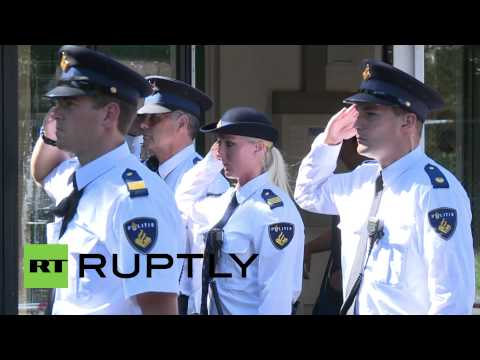 Minute - Video ID: 20140723-028 W/S Guards holding minute's silence M/S Guards holding minute's silence M/S Police officers holding minute's silence M/S Police officers holding minute's silence C/U...