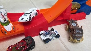 """In this video I unbox and show you 12 Hot Wheels Star Wars character cars and then I send them through the Hot Wheels Daredevil Double Loop to see if The Force can beat The Evil Empire. I show you the Luke Skywalker car, the Han Solo car, the Darth Vader car, the Darth Maul car, the Chewbacca car, 2 R2D2 cars, the C3PO car, the Tusken Raider car, the Stormtrooper car, the Yoda car, and the Clone Trooper car.Check out my other fun toy videos:Unboxing 5 Pack Shopkins Small Mart with Hidden Shopkin""""http://youtu.be/EgpZleCzmj8""""Unboxing and Playing Spiderman Villain Showdown""""http://youtu.be/ythIXRIWyU4""""Opening 8 Transformers Rescue Bots Playskool Heroes""""http://youtu.be/Yc03l9Z8H-c""""Review of Bumblebee Transformer Rescue Bot Playskool Heroes""""http://youtu.be/zAk83z3iNrk""""Playing Disney Sofia The First Forest Playset""""http://youtu.be/9gYcPLm6QiI""""Opening Shopkins 12 pack Shopkins Small Mart""""http://youtu.be/_JW85iERzb8""""Watch Assembling and Playing the Design And Drift Speedway Track Set With Micro Drifters Lightning McQueen and Dinoco Cars""""http://youtu.be/AEhokIcYRGU"""""""