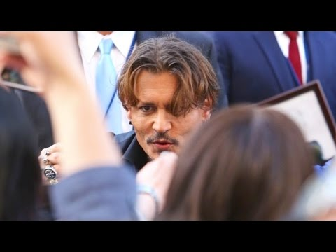 Johnny Depp Nearly Swallowed Up By A Sea Of Fans At The Pirates Premiere