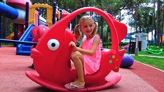Polina plays on new playground for kids.