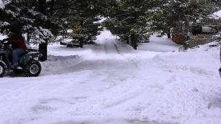 2. Plowing the driveway Yamaha 350 4x4 wolverine
