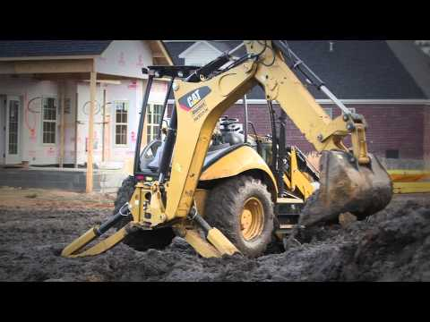 The Cat K2 Family Small Dozers are ideal for final grade work for driveway construction.