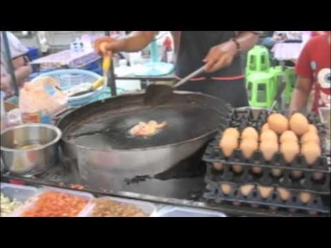 Street Cooking in Bangkok: 2 well done Pad Thai. Worth it!