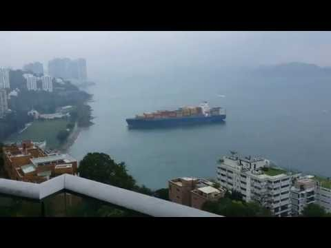 ship runs aground - Hansa Constitution container ship does not stop as it continues to head toward land resulting in a collision with the sea wall in front of the Stanley Ho Spo...