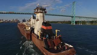 On and above the Detroit River. Crew change and delivery to the Walter J. McCarthy Jr. Algosteel turning in the river, Tug Dorothy...