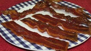 In this easy cooking video, I cook some turkey bacon and some pork bacon in my toaster oven. The toaster oven is an easy way to cook bacon and it turns out ...