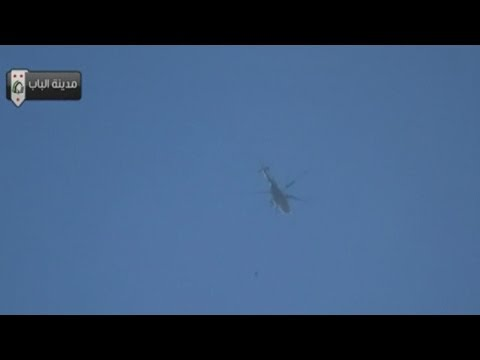 at least - Subscribe to ITN News: http://bit.ly/itnytsub At least 20 people have reportedly been killed after Syrian army helicopters dropped improvised barrel bombs on...
