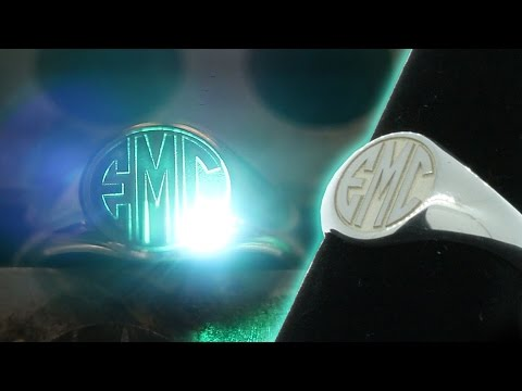 <h3>Deep Laser Engraving | Sterling Silver Monogram Signet Ring</h3>In this video we demonstrate deep laser engraving into 925 Sterling Silver to create a beautiful Monogram Signet Ring using our StarFX software. <br /><br />Our proprietary STAR-FX™ software provides a level of complex layer engraving and surface texturing never before available in today's marketplace.  Convert any sketch, drawing, or graphic image into a custom engraved work-of-art on multiple alloys including: Aluminum, Stainless Steel, Titanium, Copper, Iron, Brass, Exotic Metals, Composites, and precious alloys.  Each image can be engraved before or after custom coating (including hard coat anodize, custom color or Cerakote processes) to optimize the color fill, natural shadowing and polishing effects of the final result.