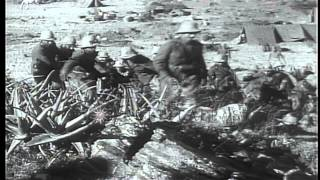 Second Italian-Ethiopian War. Two Italian Soldiers Stand By The Flag Of The Kingd...HD Stock Footage