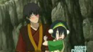 Toph glomps Zuko... and he blushes.