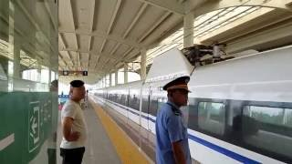 Hebi China  City pictures : High-Speed Train Arriving at Station in Hebi, Henan, China