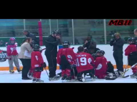 mokyboy11 - Jonathan Toews accidentally runs into a kid and sends him to the ice during a hockey camp.