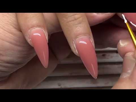 Gel nails - Stiletto nails beauty tutorial of gel nail extensions and french nail art designs