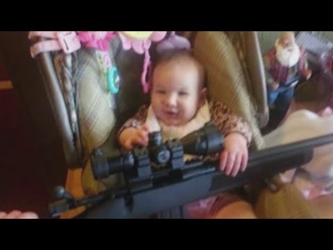 A Photo Of A 6-Month-Old Holding A Gun. How Do You Feel About It?
