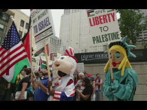 Palestine - A pro-Israel demonstration and pro-Palestinian protest faced off outside the Israeli Embassy in Chicago on Tuesday. Police closed off the whole block and patrolled the streets. After the demonstrat...