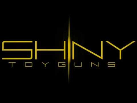 Tekst piosenki Shiny Toy Guns - Ghost Town po polsku