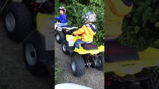 3. 3 and 4 Year old riding Suzuki quad LT-Z 50cc