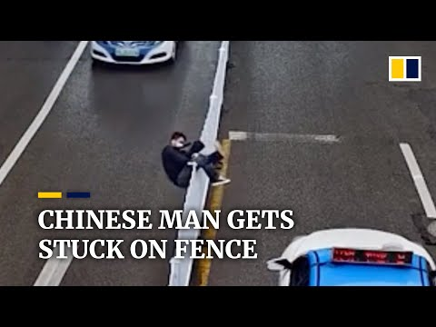Chinese man gets stuck on fence after trying to climb over it