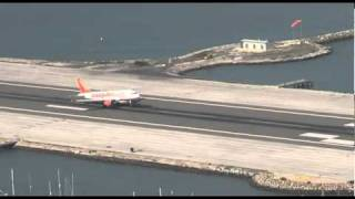 The Easyjet flight from Gatwick lands at Gibraltar airport while the traffic waits at either side of the runway. 28th October 2010 at ...