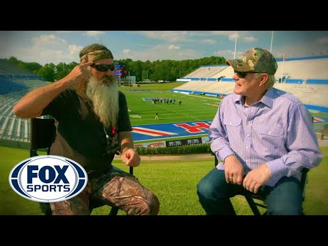 Robertson - Terry Bradshaw and Phil Robertson reunite at Louisiana Tech University for the first time since they were both quarterbacks at the school.